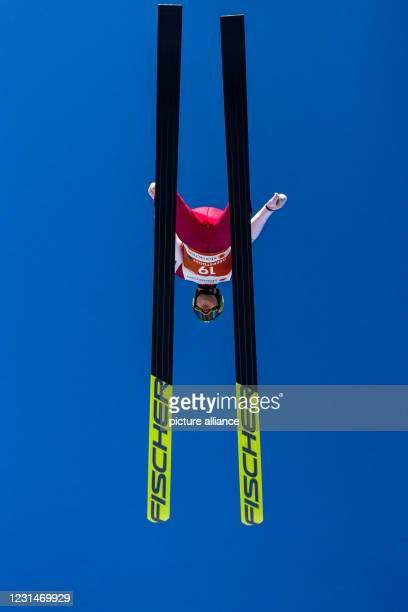 March 2021, Bavaria, Oberstdorf: Nordic skiing: World Cup, Nordic combined, ski jumping, training, men, large hill. Wille Karhumaa from Finland in...