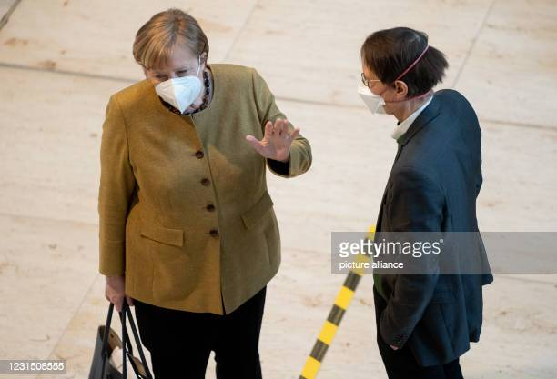 March 2021, Berlin: Chancellor Angela Merkel and Karl Lauterbach, SPD health expert, talk on the sidelines of the 215th session of the Bundestag....
