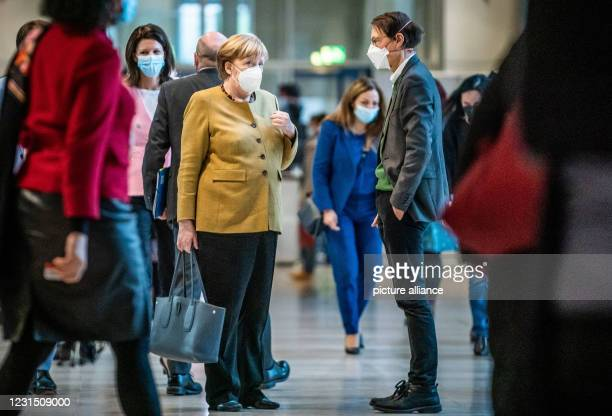 March 2021, Berlin: Chancellor Angela Merkel talks to Karl Lauterbach, SPD health expert, after the debate in the German Bundestag. In its session,...