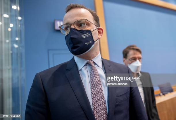 March 2021, Berlin: Jens Spahn , Federal Minister of Health, walks in front of Karl Lauterbach , health expert, after the press conference on the...