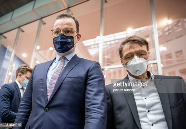 March 2021, Berlin: Jens Spahn , Federal Minister of Health, walks next to Karl Lauterbach , health expert, after the press conference on the current...