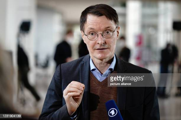 March 2021, Berlin: Karl Lauterbach, health expert of the SPD, gives an interview after Chancellor Merkel answered the questions of the members of...
