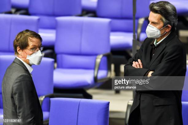 March 2021, Berlin: Karl Lauterbach , SPD health expert, and Rolf Mützenich, chairman of the SPD parliamentary group, attend the 215th session of the...