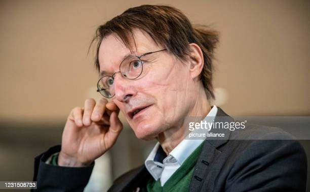 March 2021, Berlin: Karl Lauterbach, SPD health expert, talks to reporters in the German Bundestag. In its session, the parliament deals with the...