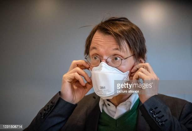 March 2021, Berlin: Karl Lauterbach, SPD health expert, walks with mask in the German Bundestag. In its session, the parliament deals with the agenda...