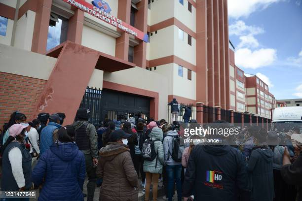 March 2021, Bolivia, El Alto: Sutdents stand outside the UPEA University where at least three students fell into the courtyard because of a rail that...