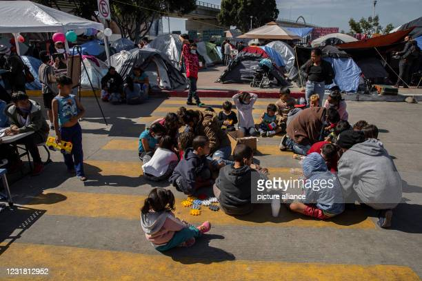March 2021, Mexico, Tijuana: Children from Central America are taught and play at a migrant camp on the grounds of the National Institute for...