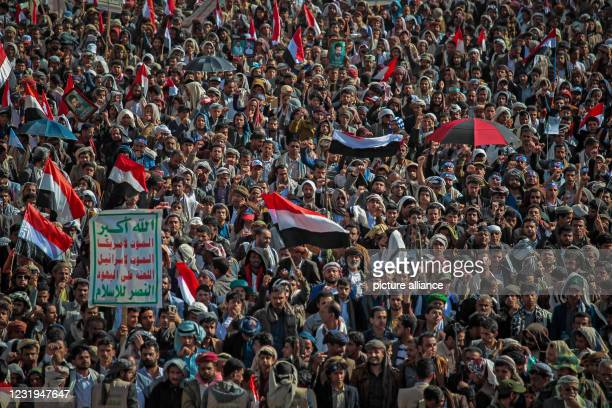 March 2021, Yemen, Sanaa: Houthi supporters hold flags during a rally marking the sixth anniversary of the launch of the Saudi-led coalition's...