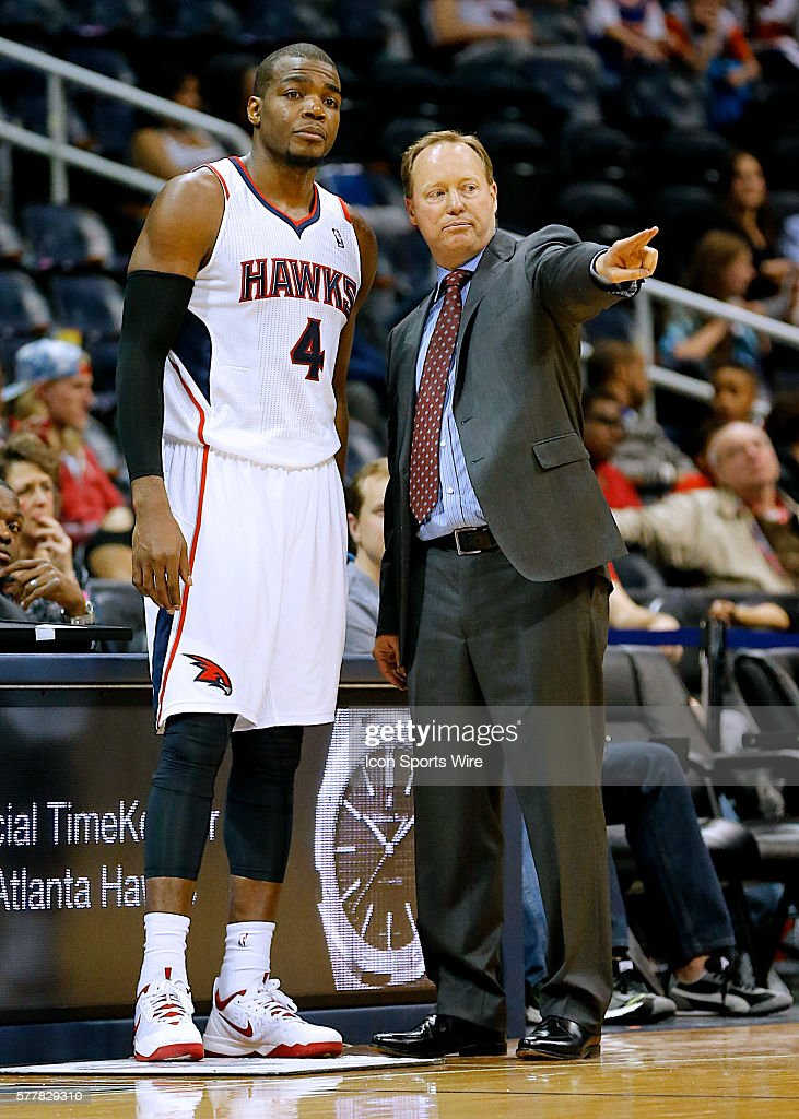 Atlanta Hawks head coach Mike Budenholzer discusses strategy with Atlanta Hawks Forward Paul Millsap (4) [1486] during the NBA match up between the Atlanta Hawks and the New Orleans Pelicans at Philips Arena in Atlanta, Georgia. The New Orleans Pelicans won the game 111-105 to end the Hawks win streak at five games.