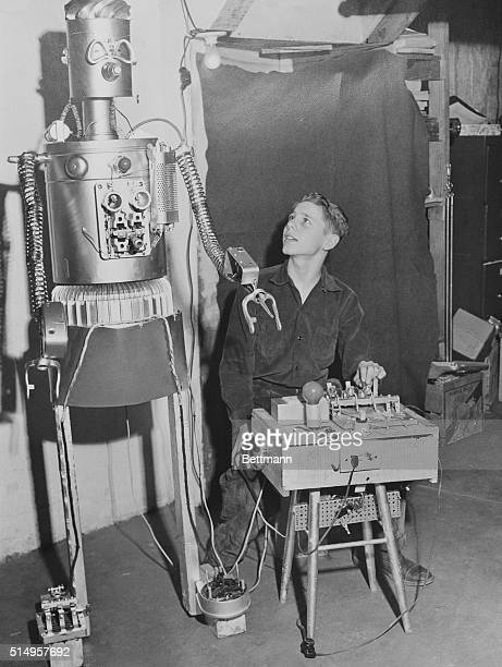 March 22 1954 Cranston Rhode Island Gismo the robot and his 13 year old inventor Sherwood Woody Fuehrer read the paper together Woody made the five...