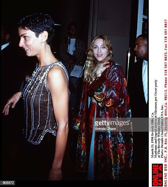 March 22 1998 Beverly Hills Madonna with friend Ingrid as he arrives atThe Miramax Oscar''98 pre Oscar party at The Beverly Wilshire Hotel