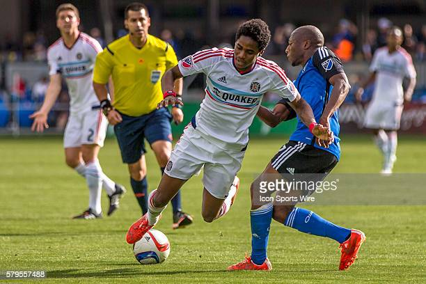 Chicago Fire defender/midfielder Joevin Jones is fouled by San Jose Earthquakes midfielder Sanna Nyassi during an MLS soccer game between the San...
