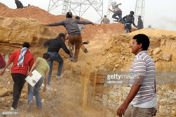 March 22 Mokattam Hills, Cairo, Egypt. Opposition rioters are chasing retreating Muslim Brotherhood members. Clashes in the Egyptian capital erupted...