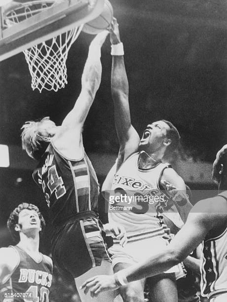 March 24 1978 Philadelphia's Joe Bryant attempts a lay up over Milwaukee's Kent Benson as Milwaukee's John Gianelli looks on in the first period here