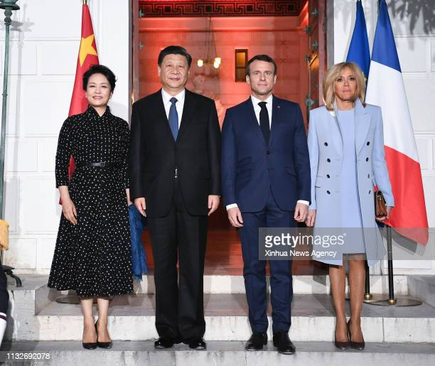 NICE March 24 2019 Chinese President Xi Jinping 2nd L and his wife Peng Liyuan 1st L pose for a group photo with French President Emmanuel Macron and...