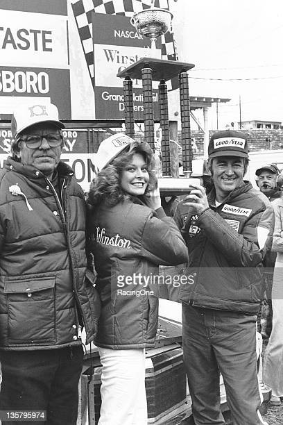 Bobby Allison is joined by car owner Bud Moore in victory lane at North Wilkesboro Speedway after Allison was victorious in the Northwestern Bank 400...