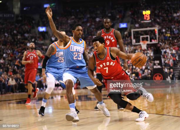 TORONTO ON March 25 In first half action on his birthday Toronto Raptors guard Kyle Lowry drives around LA Clippers guard and former team mate Lou...