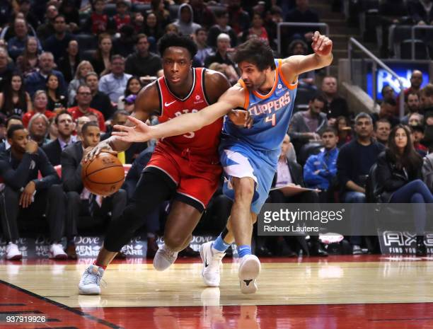 TORONTO ON March 25 In first half action Toronto Raptors forward OG Anunoby and LA Clippers guard Milos Teodosic battle for the ball The Toronto...