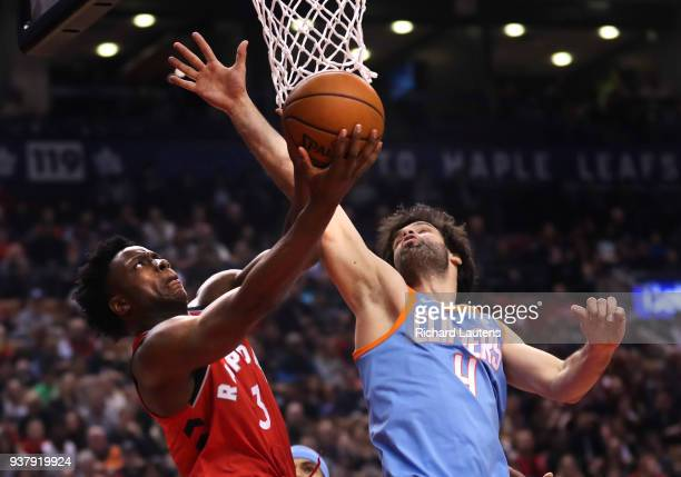 TORONTO ON March 25 In first half action Toronto Raptors forward OG Anunoby battles with LA Clippers guard Milos Teodosic under the hoop The Toronto...