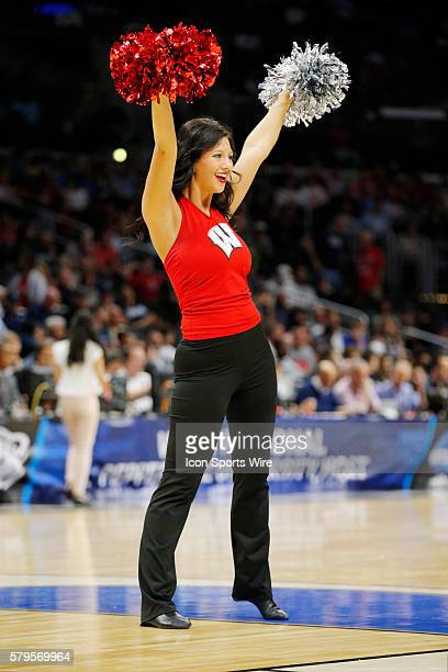 Wisconsin Badgers cheerleader performs during the NCAA Division 1 Men's Basketball Championship Sweet Sixteen round game between the North Carolina...