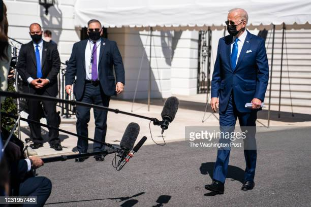 March 26, 2021: President Joe Biden speaks with the press before departing on board Marine One on the south lawn of the White House on March 26, 2021.