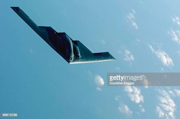 march 27, 2003 - a b-2 spirit proceeds to an undisclosed location after flying a mission over iraq in support of operation iraqi freedom.   - stealth bomber stock photos and pictures