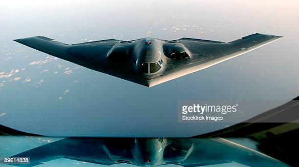 march 27, 2003 - a b-2 spirit, returning from a mission supporting operation iraqi freedom, takes on fuel from a kc-135 stratotanker over the indian ocean.   - stealth bomber stock photos and pictures