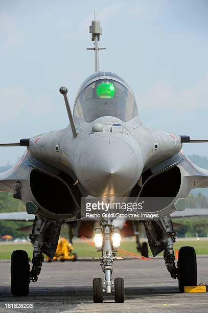 march 27, 2013 - a dassault rafale fighter aircraft of the french air force parked at langkawi airport, malaysia. - dassault rafale stock pictures, royalty-free photos & images