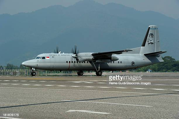 March 28, 2013 - A Fokker F-27 Friendship of the Singapore Air Force arriving at Langkawi Airport, Malaysia.
