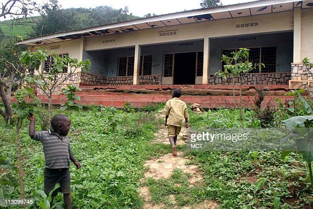 March 29 2004 Children play outside the abandoned home of Felicien Kabuga in the village of Nyanga Rwanda where Kabuga was born Kabuga's privately...