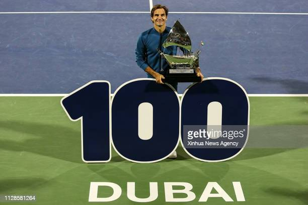 DUBAI March 3 2019 Roger Federer of Switzerland celebrates his 100th career title after winning the singles final match between Roger Federer of...