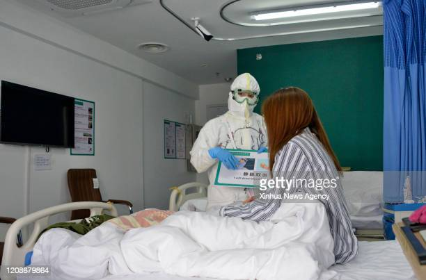 BEIJING March 30 2020 A medical worker communicates with a patient at Xiaotangshan Hospital in Beijing capital of China March 30 2020 Xiaotangshan...