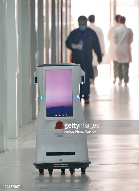BEIJING March 30 2020 A robot is on service at Xiaotangshan Hospital in Beijing capital of China March 30 2020 Xiaotangshan Hospital which was...