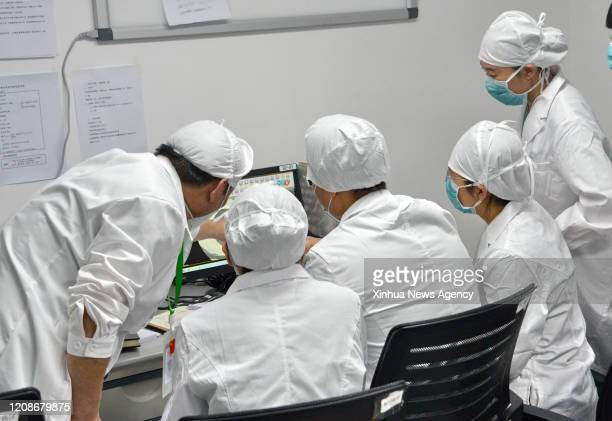 BEIJING March 30 2020 Medical staff discuss patients' condition at Xiaotangshan Hospital in Beijing capital of China March 30 2020 Xiaotangshan...