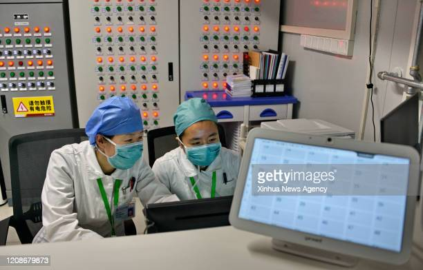 BEIJING March 30 2020 Medical staff work at Xiaotangshan Hospital in Beijing capital of China March 30 2020 Xiaotangshan Hospital which was...