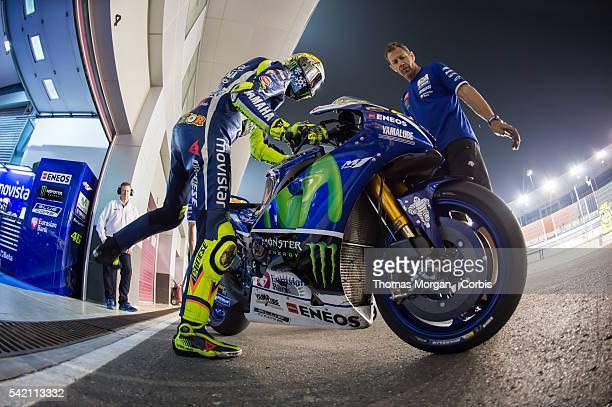 DOHA QATAR March 3rd 2016 Losail Circuit Qatar Valentino Rossi who rides Yamaha for Movistar Yamaha MotoGP mounts his motorbike at the final...