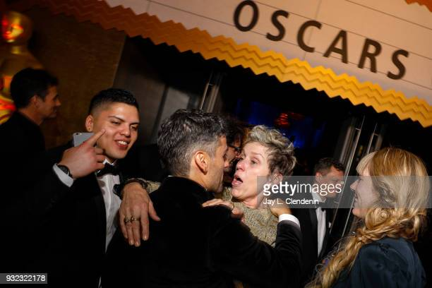 HOLLYWOOD CA March 4 2018With her son Pedro far left Best Actress Oscar winner Frances McDormand center talks with Oscar Isaac and Elvira Lind about...