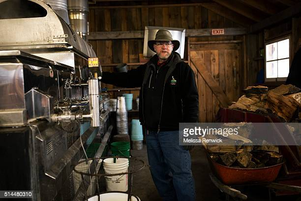 TORONTO ON March 4 Jim Aikenhead program instructor demonstrates how maple sap is turned into maple syrup through an evaporator at the Mountsberg...