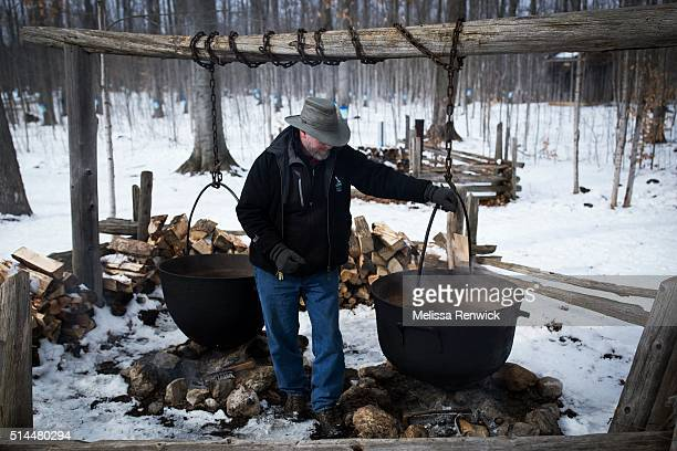 TORONTO ON March 4 Jim Aikenhead shows the iron kettles that were once used to boil sap to syrup at the Mountsberg Conservation Area near...