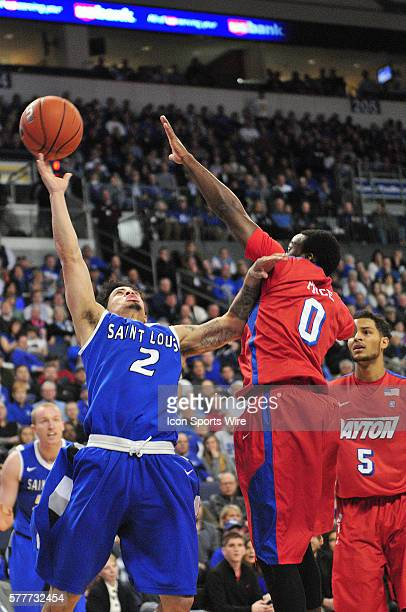 Saint Louis University guard Austin McBroom shoots over Dayton Flyers guard Khari Price during an Atlantic 10 Conference basketball game between the...