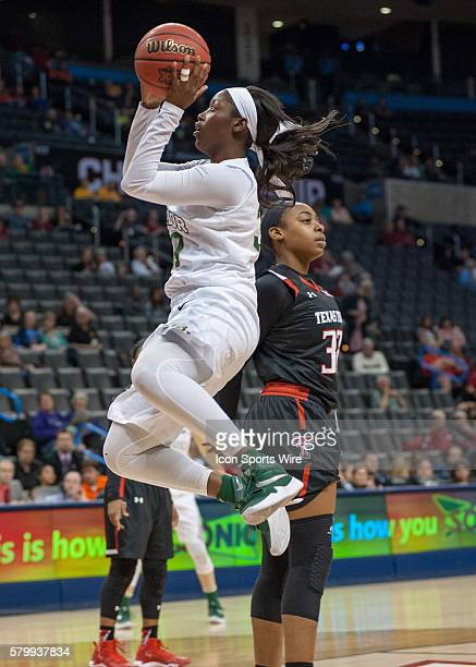 Baylor Alexis Jones goes in for the easy layup bypassing Texas Tech Dayo Olabode during the Big 12 Women's Championship at the Chesapeake Energy...