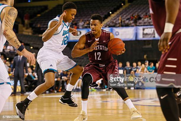 Charleston Cougars guard Cameron Johnson tries to keep North CarolinaWilmington Seahawks guard CJ Bryce away from the ball during the game between...
