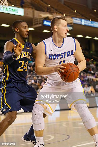 Hofstra Pride forward Rokas Gustys looks to pass the ball during the game between Hofstra vs Drexel at Royal Farms Arena in Baltimore MD