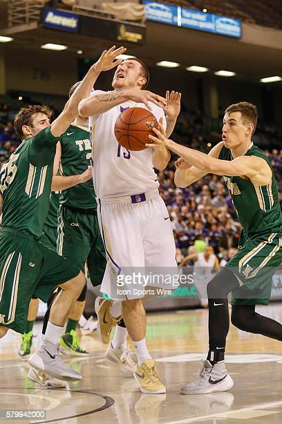 James Madison Dukes forward Tom Vodanovich gets fouled by William Mary defenders during the game between James Madison vs William Mary at Royal Farms...