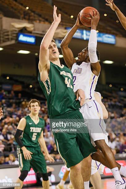 James Madison Dukes guard Ron Curry is fouled by William Mary Tribe forward Jack Whitman during the game between James Madison vs William Mary at...