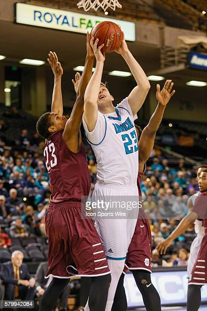 North CarolinaWilmington Seahawks center CJ Gettys attempts a layup over Charleston Cougars forward Nick Harris during the game between UNCW vs...