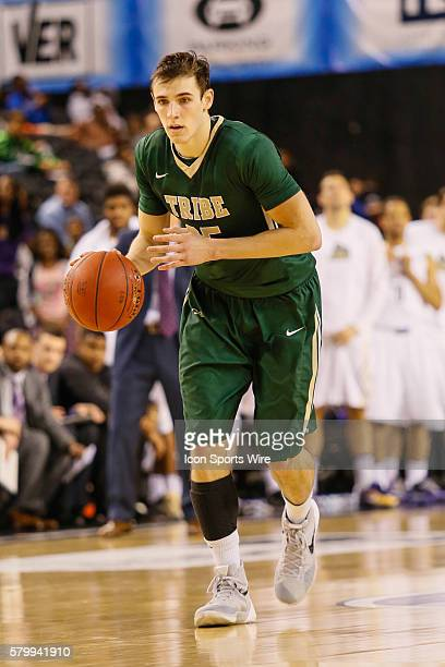 William Mary Tribe guard Terry Tarpey brings the ball down the court during the game between James Madison vs William Mary at Royal Farms Arena in...