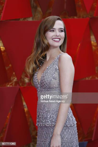 LOS ANGELES March 5 2018 US actress Zoey Deutch arrives for the red carpet of the 90th Academy Awards at the Dolby Theater in Los Angeles the United...