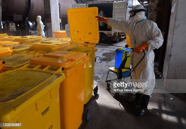 March 5, 2020 -- A worker disinfects medical waste containers at Wuhan Beihu Yunfeng Environmental Technology Co., Ltd. In Qingshan District of...