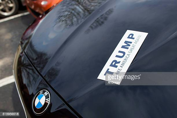 STATES March 5 A bumper sticker in support of Republican presidential candidate Donald Trump is seen on a car hood at the opening of the Donald Trump...